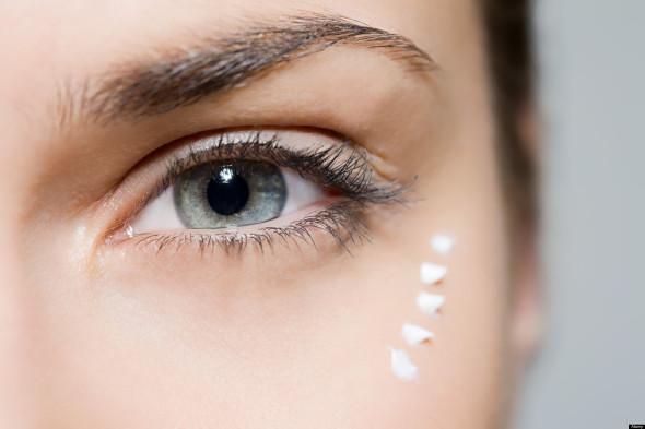 B24FAG Woman with eye cream