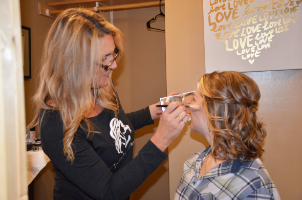 captivating beauty applying makeup on a bride at pine peaks event center
